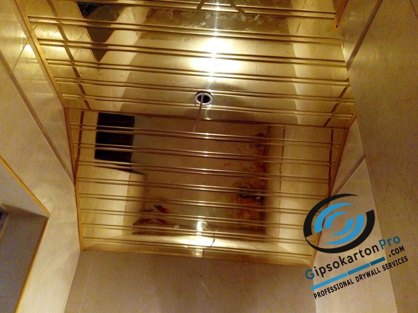 Окачени тавани за баня Хънтър Дъглас - златист